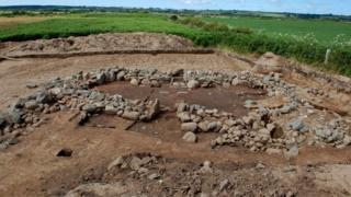 Remains of a house found at Rhuddgaer, near Newborough by the Gwynedd Archaeological Trust