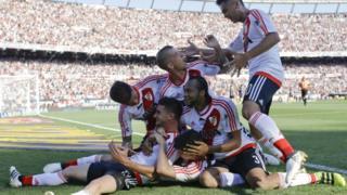 River Plate's forward Lucas Alario, left, celebrates scoring against Boca Juniors
