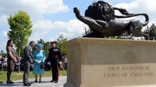 Queen Elizabeth II views the new Duke of Lancaster's Regimental memorial during a service at the National Memorial Arboretum in Alrewas, Staffordshire.