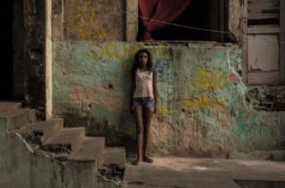 Taina, 12, has been squatting in the IBGE building with her family for 4 - 5 years. Abandoned IBGE building, 'Favela' Mangueira community, Rio de Janeiro, Brazil.