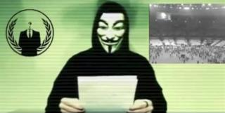 A man wearing a mask associated with Anonymous makes a statement in this still image from a video released on November 16, 2015