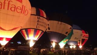 Line of lit up balloons