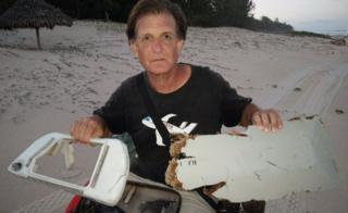 Blaine Gibson showing two pieces of possible MH370 debris found in Madagascar