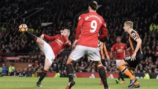 Wayne Rooney kicking ball