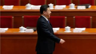 China's President Xi Jinping arrives for the second plenary session of the National People's Congress