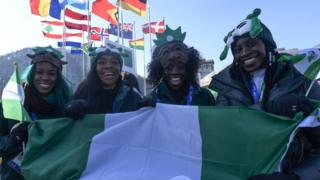 Nigeria's women's bobsleigh and skeleton team members Seun Adigun, Ngozi Onwumere, Akuoma Omeoga and Simidele Adeagbo attend a welcoming ceremony for the team in the Olympic Village in Pyeongchang ahead of the Pyeongchang 2018 Winter Olympic Games on February 6, 2018.