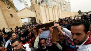 "Relatives react as they mourn for the victims of the Palm Sunday bombings during their funeral at the Monastery of Saint Mina ""Deir Mar Mina"" in Alexandria"
