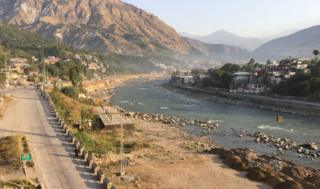 A view of Muzaffarabad. Neelum River divides the main city from hillside settlements