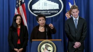 US Attorney General Loretta Lynch (C) speaks during a news conference.