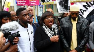 Shadow Home Secretary, Diane Abbott speaks at a protest outside Stoke Newington police station over the death of Rashan Charles,
