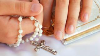 Rosary beads in hands