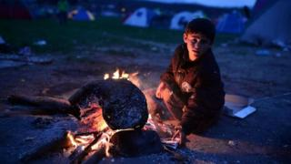 Refugee child at bonfire in makeshift camp at the Greek-Macedonian border near village of Idomeni. Photo: March 2016