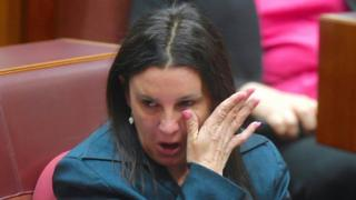 Jacqui Lambie wipes her tears away
