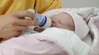 A baby being bottle-fed, file pic