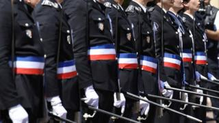 "Newly promoted police officers stand guard during a ceremony of the 20th promotion of the police officers at the Saint-Cyr national school of police on June 24, 2016 in the Saint-Cyr-au-Mont-d""Or near Lyon"