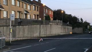 Empty road cordoned off by police