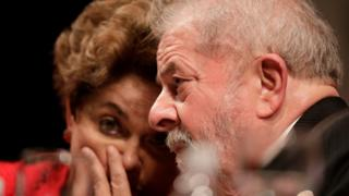 "Former Brazilian President Luiz Inacio Lula da Silva speaks with former Brazilian President Dilma Rousseff during the inauguration of the new National Directory of the Workers"" Party, in Brasilia, Brazil July 5, 2017"