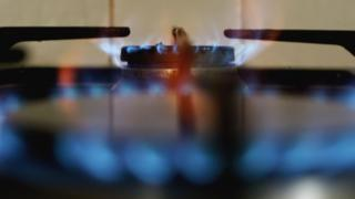 Close up of the flames of two gas hobs
