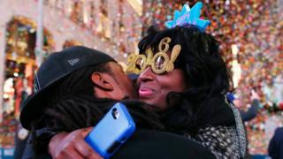 Revelers hug after the ball drop during New Year's Eve celebrations in Times Square