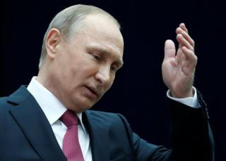 Russian President Vladimir Putin gestures as he speaks to journalists following a live nationwide broadcast call-in in Moscow, 15 June