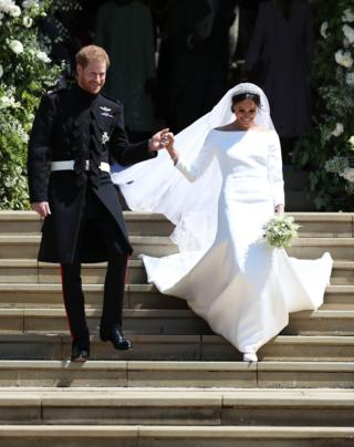 Prince Harry, Duke of Sussex and Meghan, Duchess of Sussex leave St George's Chapel, Windsor Castle after their wedding ceremony on 19 May 2018
