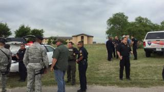 Police respond to the shooting at Lackland