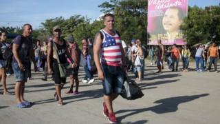 Cuban migrants walk toward the Costa Rican border after riot polices fired tear gas at the border between Nicaragua and Costa Rica on 15 November, 2015