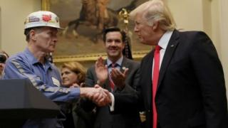 A coal miner worker shakes hands with President Donald Trump (16 February 2017)