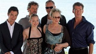 British actor Dominic Cooper, British actor Colin Firth, US singer Amanda Seyfried, Swedish actor Stellan Skarsgard, US singer Meryl Streep and Irish actor Pierce Brosnan poise during a photo event for the graduation of the new film 'Mamma Mia' at the Lagonissi Grand Resort, some 40 kms south of Athens on Jun 28, 2008