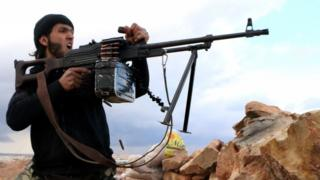 A rebel fighter near the restive Syrian city of Aleppo (25 February 2014)