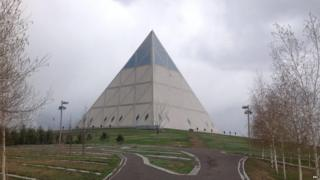 A pyramid-shaped building designed by Norman Foster stands in the Kazakh capital Astana