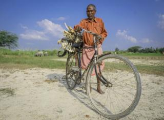 Mr. Lal carries the bones in his cycle
