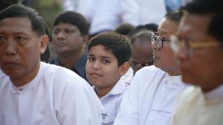 One of the King's Indian great-great-great grandsons looks on at the memorial ceremony