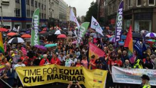 The march culminated in a rally at Belfast City Hall