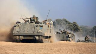 Israeli armoured personnel carriers roll towards the Israeli-Gaza border (20 July 2014)