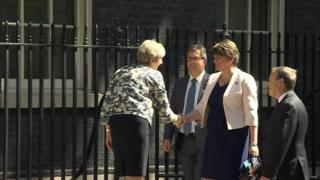 Theresa May shakes Arlene Foster's hand in Downing Street as she arrives for talks