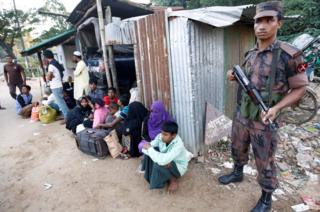 Policeman stands guard after catching Rohingya Muslims illegally crossing at a border check point in Cox's Bazar, Bangladesh, November 21, 2016