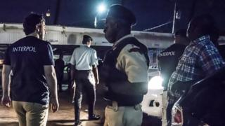 Interpol officers and local police raid night clubs in Georgetown, Guyana