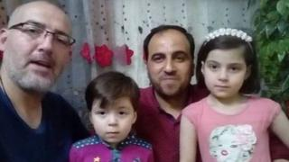 Photo of journalist Khaled Iskef with Omran Daqneesh (2nd left), his father and sister (5 June 2017)
