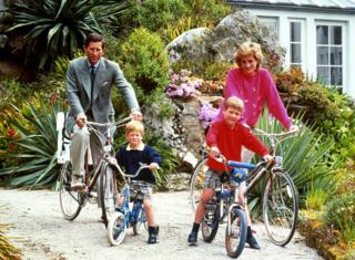The Prince and Princess of Wales with Harry and William on bikes