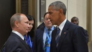 Russian President Vladimir Putin (L) meets with US President Barack Obama