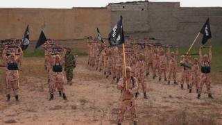"""Image purportedly showing young boys known as the """"lion cubs"""" holding rifles and Islamic State flags as they exercise at an IS training camp in Tal Afar, northern Iraq (27 September 2015)"""