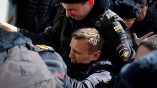 Police officers detain anti-corruption campaigner and opposition figure Alexei Navalny during a rally in Moscow