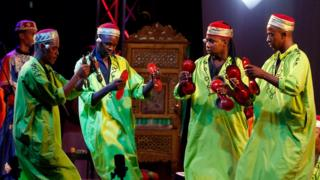 Members of the groups Diwan Ajam Stambali of Tunisia, Gnaoua of Morocco and Diwan of Algeria perform during the 53rd edition of the International Festival of Carthage at Carthage National Museum in Tunis, 31 August 2017