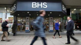 Shoppers walk past BHS