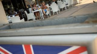 Union Jack in front of cafe in Spain
