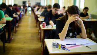 Teenagers taking an exam, file pic, 24 Jun 15