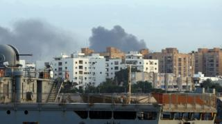 Smoke rises over the Libyan capital Tripoli after clashes on May 26, 2017