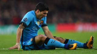 Luis Suarez of Barcelona holds his injured leg