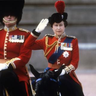 Queen Elizabeth II taking the salute of the Household Guards regiments during the Trooping of the Colour ceremony in London
